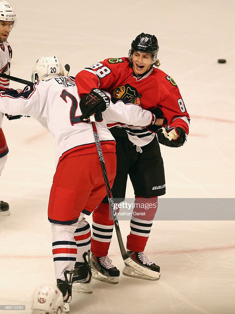 Patick Kane #88 of the Chicago Blackhawks is tied up by <a gi-track='captionPersonalityLinkClicked' href=/galleries/search?phrase=Tim+Erixon+-+Hockey+su+ghiaccio&family=editorial&specificpeople=8546945 ng-click='$event.stopPropagation()'>Tim Erixon</a> #20 of the Columbus Blue Jackets at the United Center on March 1, 2013 in Chicago, Illinois. The Blackhawks defeated the Blue Jackets 4-3 in overtime.