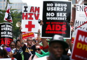 HIV patient Aaron Laxton of St Louis Missouri and other activists participate in a march from the Washington Convention Center to the White House...