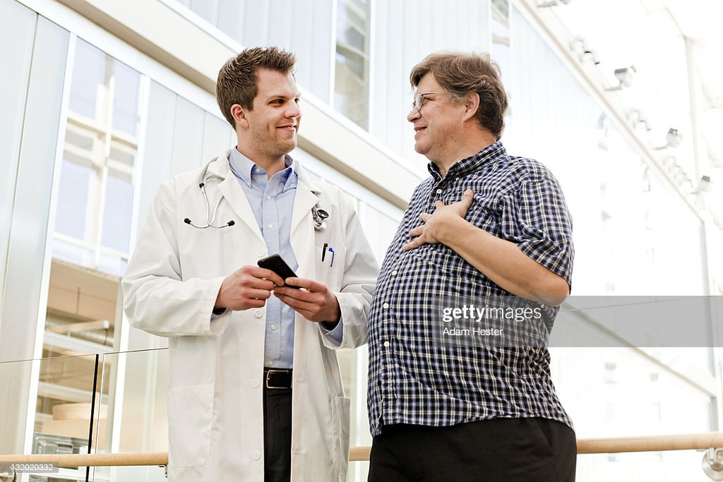 A patient and doctor talking together. : Stock Photo