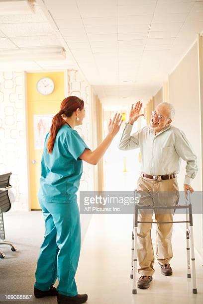 Patient and nurse high five