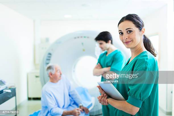 Patient and nurse in CAT scan in a hospital.