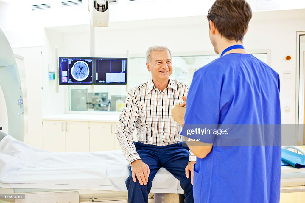 Patient at a computer tomography exam : Stock Photo