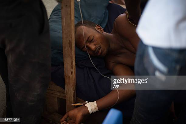 A patient at Kismayo General Hospital lies in a bed during an exam in the portcity of Kismayo 500km south of Somalia's capital on March 15 2013 This...