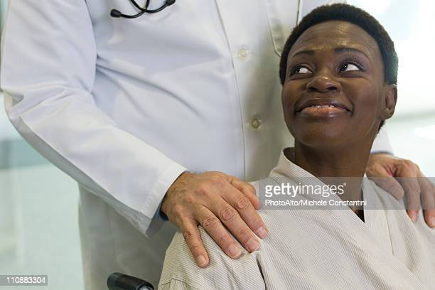 Patient being reassured by doctor
