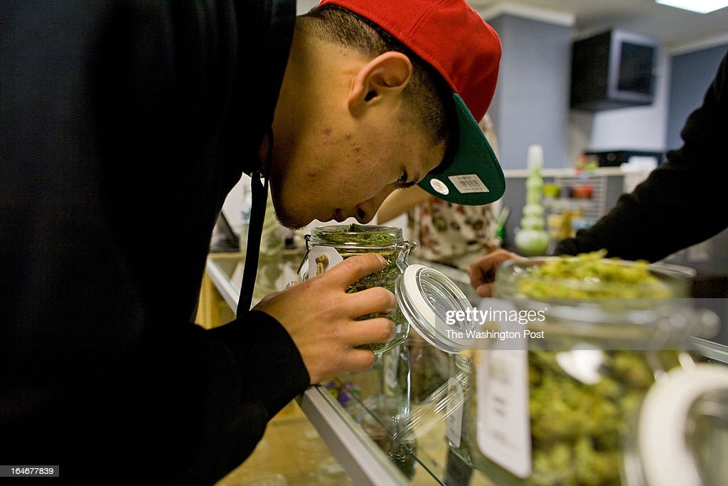 Patient Benito Marta smells a jar of cannabis inside a Good Meds medical cannabis center in Lakewood, Colorado, U.S., on Monday, March 4, 2013. This is at a Good Meds medical cannabis center in Lakewood, and is one of the facilities that Kristi Kelly, Co-Founder of Good Meds Network, operates.