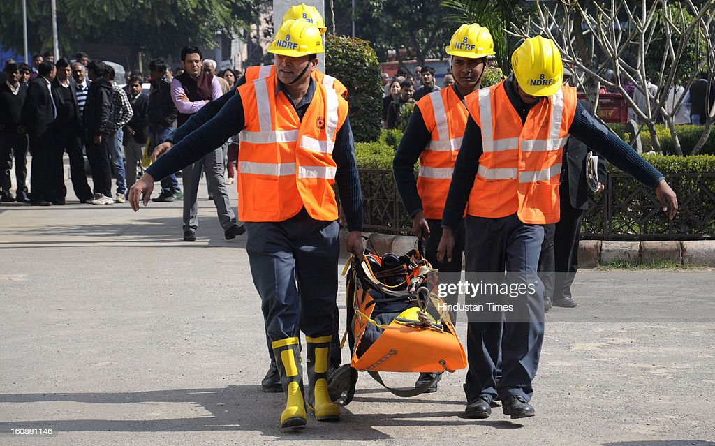 Patient carried on a stretcher into an ambulance during a Mock earthquake rescue drill, at Mini Secretariat, on February 7, 2013 in Gurgaon, India. Mock drill organized by Gurgaon Disaster Management Authority (GDMA) and the National Disaster Management Authority (NDMA) at many places in city to check the preparedness of officials and citizens to tackle natural calamities.