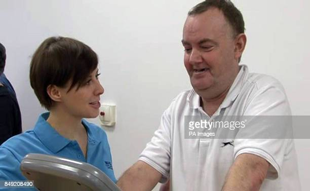 Patient David McCormack works out during a visit by Scottish Health Secretary Alex Neil watches to the new Victoria Hospital in Glasgow today to see...