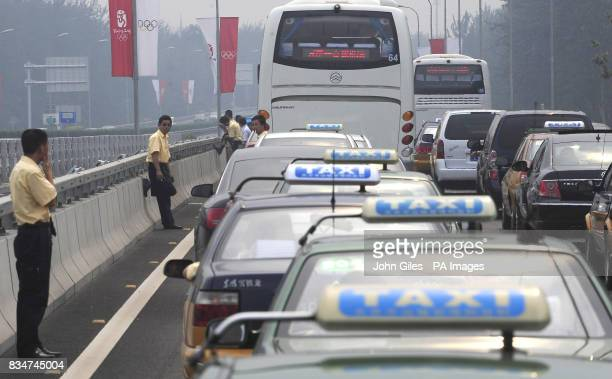 Patient drivers in a Beijing traffic jam today who enjoyed a cigarette while stuck in stationary vehicles on roads into Beijing as it builds towards...