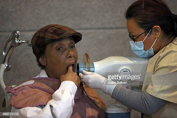 A patient gets a dental xray during the Bridges to Health medical and dental clinic on April 23 2014 in San Francisco California Hundreds of people...
