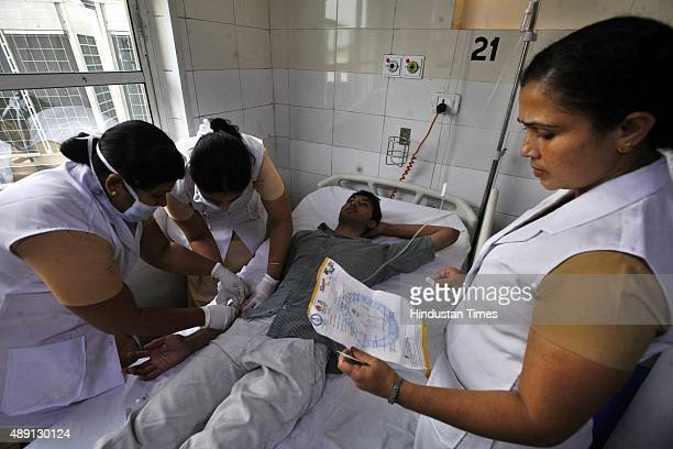 A patient gets routine checkup inside a dengue ward of Rajiv Gandhi Superspecialty Hospital on September 19 2015 in New Delhi India As Delhi battles...