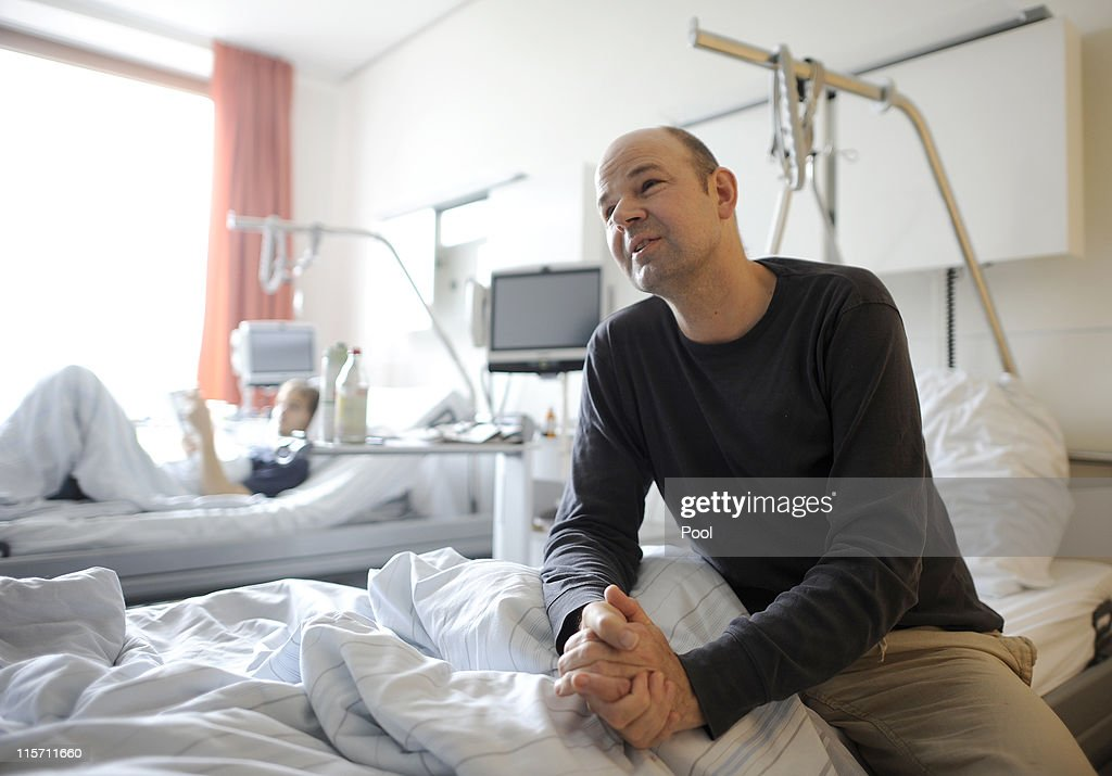 Patient Holger Radloff, infected with EHEC, sits on his bed in an isolation area of the University Clinic Eppendorf (UKE) on June 8, 2011 in Hamburg, Germany. On Wednesday German ministers defended their response to the E.coli outbreak, that has killed 24 people and signalled possible changes in the way the country handles health crises in the future.