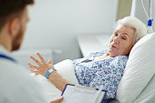 Aged patient telling her doctor how she feels