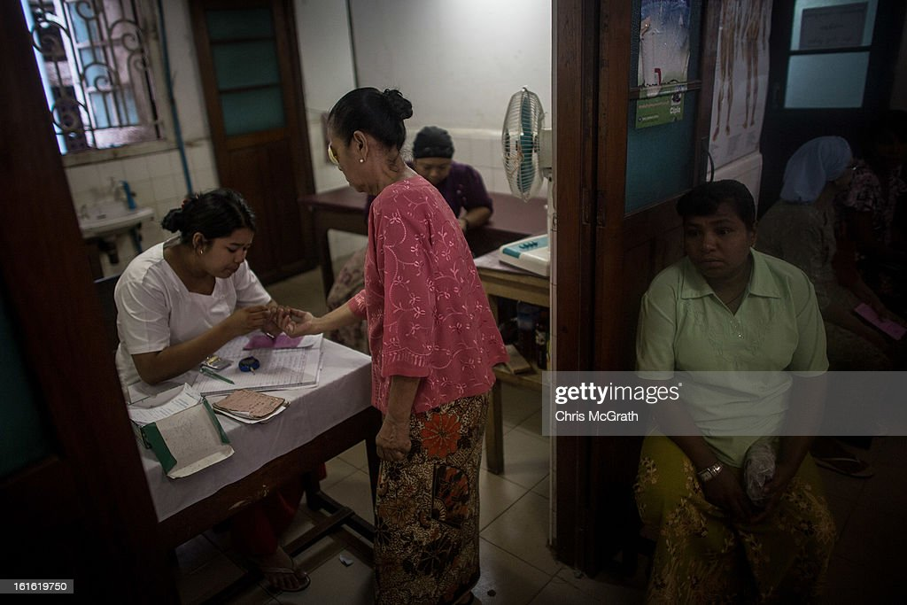 A patient is seen by a doctor at the Free Muslim Hospital on February 13, 2013 in Yangon, Burma. The Free Muslim Hospital was established in 1937, the 66 doctors on the roster see an average of 400 patients a day. As the country goes through sweeping political and economic reforms, many are hopeful that after decades of neglect the healthcare system will also benefit from the changes. Although health budgets have increased the state health system is still underfunded and struggles to provide basic healthcare as well as essential medicines for treating HIV, Malaria and TB. With sanctions being lifted it is hopeful that again the flow of medical equipment, medicines and the presence of NGO's will increase.