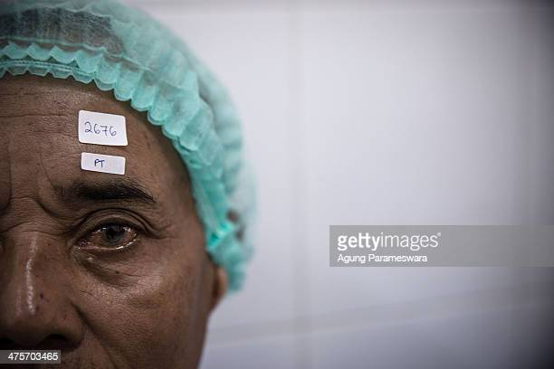 A patient is shown before cataract surgery at Udayana Army Hospital March 1 2014 in Denpasar Bali Indonesia More than 400 patients received free...