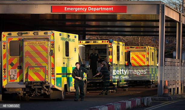 A patient is taken from a ambulance parked outside the Accident and Emergency department of Gloucestershire Royal Hospital on January 6 2015 in...