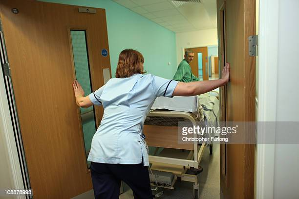 A patient is taken to the operating theatre in the recently opened Birmingham Queen Elizabeth Hospital on February 7 2011 in Birmingham England The...