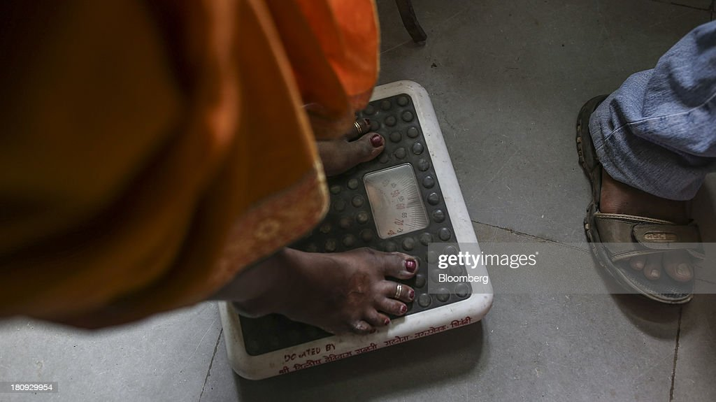 A patient is weighed at the Bombay Leprosy Project (BLP) referral center in Mumbai, India, on Tuesday, Sept. 10, 2013. While leprosy, described in Indian texts from the 6th century BC, has been cleared from the developed world, its regaining ground in India, which has become the biggest source of cases imported into the U.K. and Australia. Photographer: Dhiraj Singh/Bloomberg via Getty Images