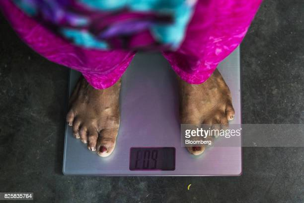 A patient is weighed during a free doortodoor screening program conducted by Public Health Foundation of India and funded by Eli Lilly Co at a home...