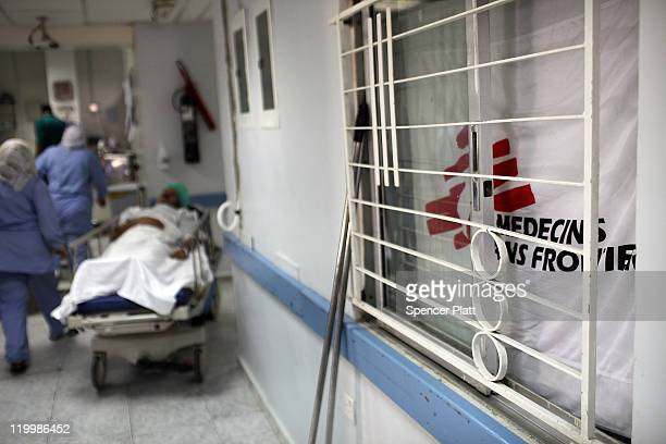 A patient is wheeled to surgery at the Red Crescent Hospital for victims of Iraq violence where Doctors Without Borders/Medecins Sans Frontieres...