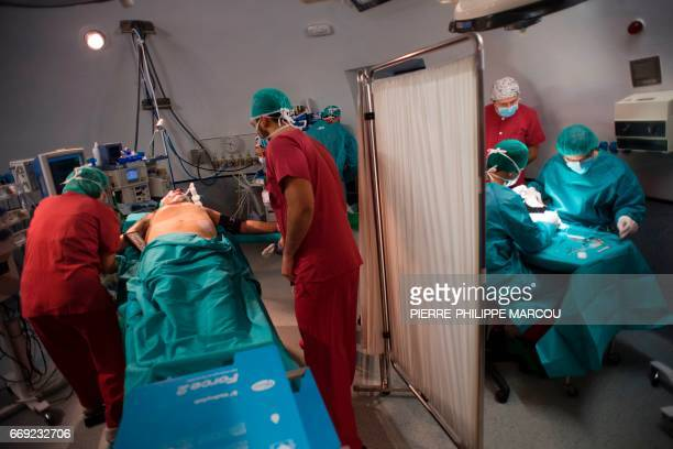 Patient Juan Benito Druet is prepared for a renal transplantation at La Paz hospital in Madrid on February 28 2017 Doctors in Spain performed 4818...