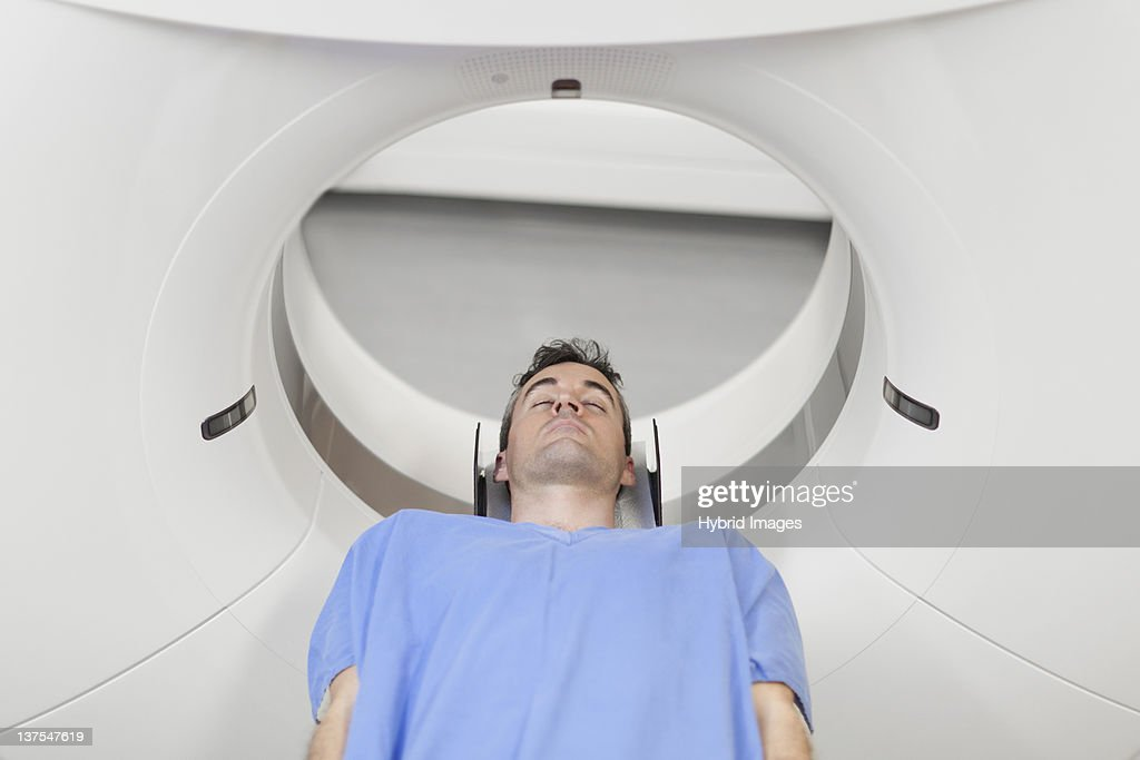 Patient laying in CT scanner in hospital : Stock Photo