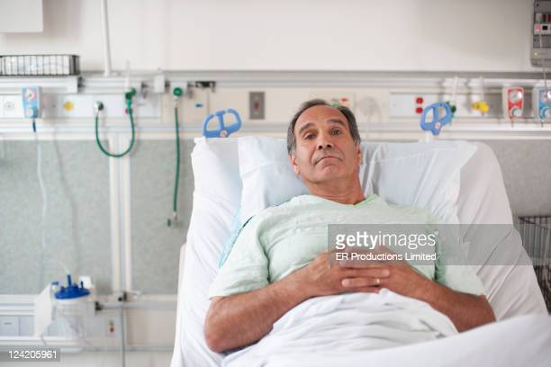 Patient laying in hospital bed