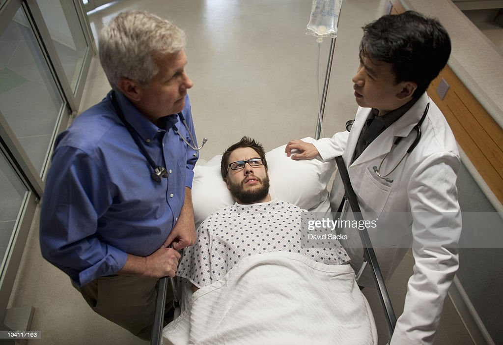 Patient listening to doctors in hospital : Stock Photo