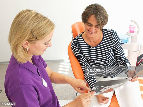 Patient looking at brochure for dental implants