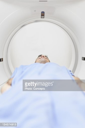 Patient lying in CT scanner : Stock Photo