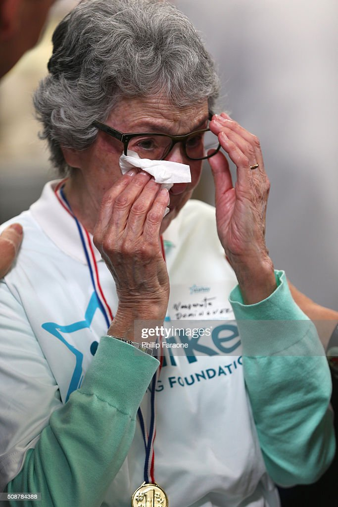 Patient Margarita reacts after being fitted with and given a hearing at the Starkey Hearing Foundation hearing mission during Super Bowl weekend 2016 at San Francisco State University on February 6, 2016 in San Francisco, California.