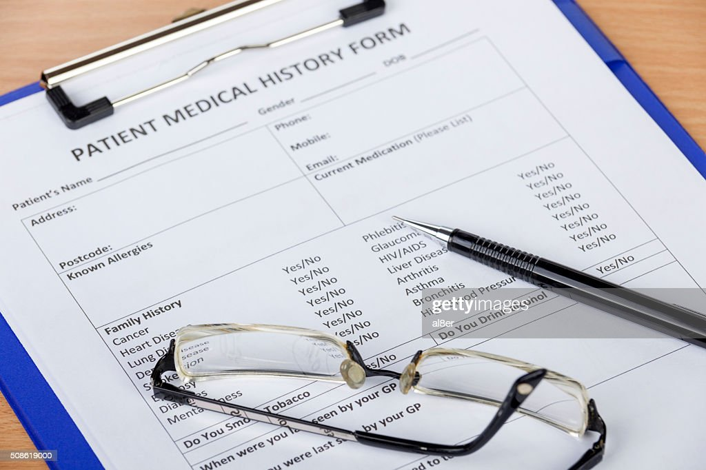 Patient medical history form on clipboard with pen and eyeglasse : Stock Photo