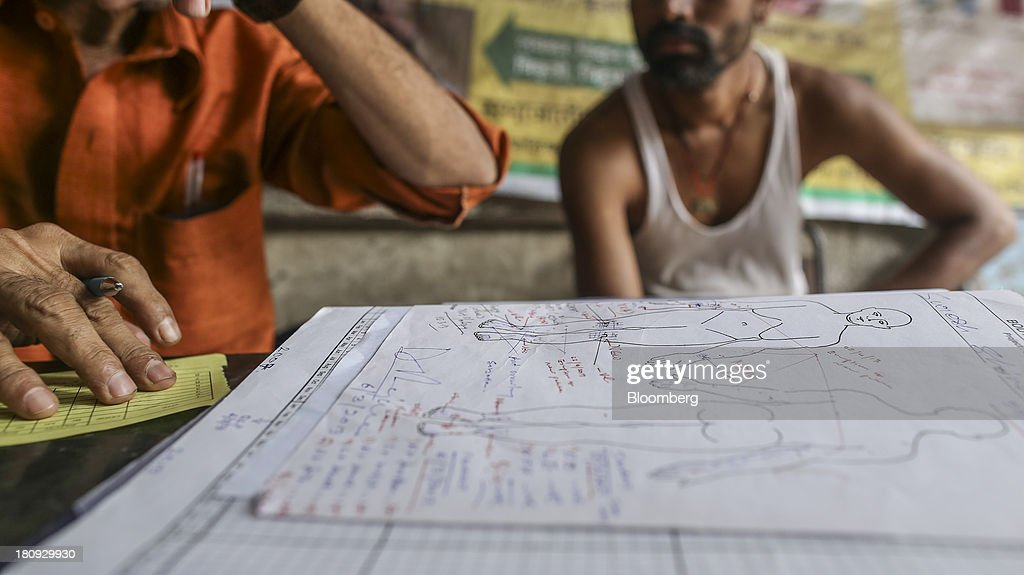 Patient notes are written on a medical sheet with human body diagrams at the Bombay Leprosy Project (BLP) referral center in Mumbai, India, on Tuesday, Sept. 10, 2013. While leprosy, described in Indian texts from the 6th century BC, has been cleared from the developed world, its regaining ground in India, which has become the biggest source of cases imported into the U.K. and Australia. Photographer: Dhiraj Singh/Bloomberg via Getty Images