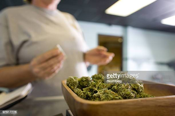A patient purchases medical marijuana at the Highland Health medical dispensary and wellness center in Denver Colorado US on Wednesday Nov 4 2009...