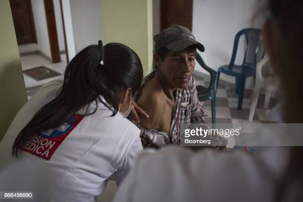 A patient receives a vaccination at an Indigenous Organization of Putumayo medical center after landslides in Mocoa Putumayo Colombia on Monday April...