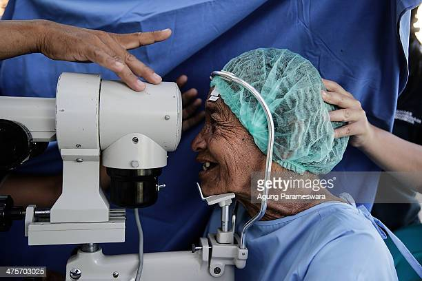 A patient receives treatment before cataract surgery at Udayana Army Hospital on March 1 2014 in Denpasar Bali Indonesia More than 400 patients...