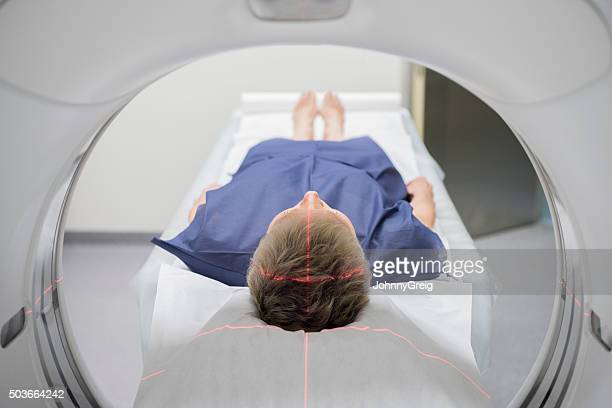 Patient receiving a CAT scan in hospital