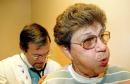 Patient Robbie Roach exhales as Pulmonologist Dr Loyd Whitley listens with a stethoscope during a an office visit January 29 2003 in Bossier City...