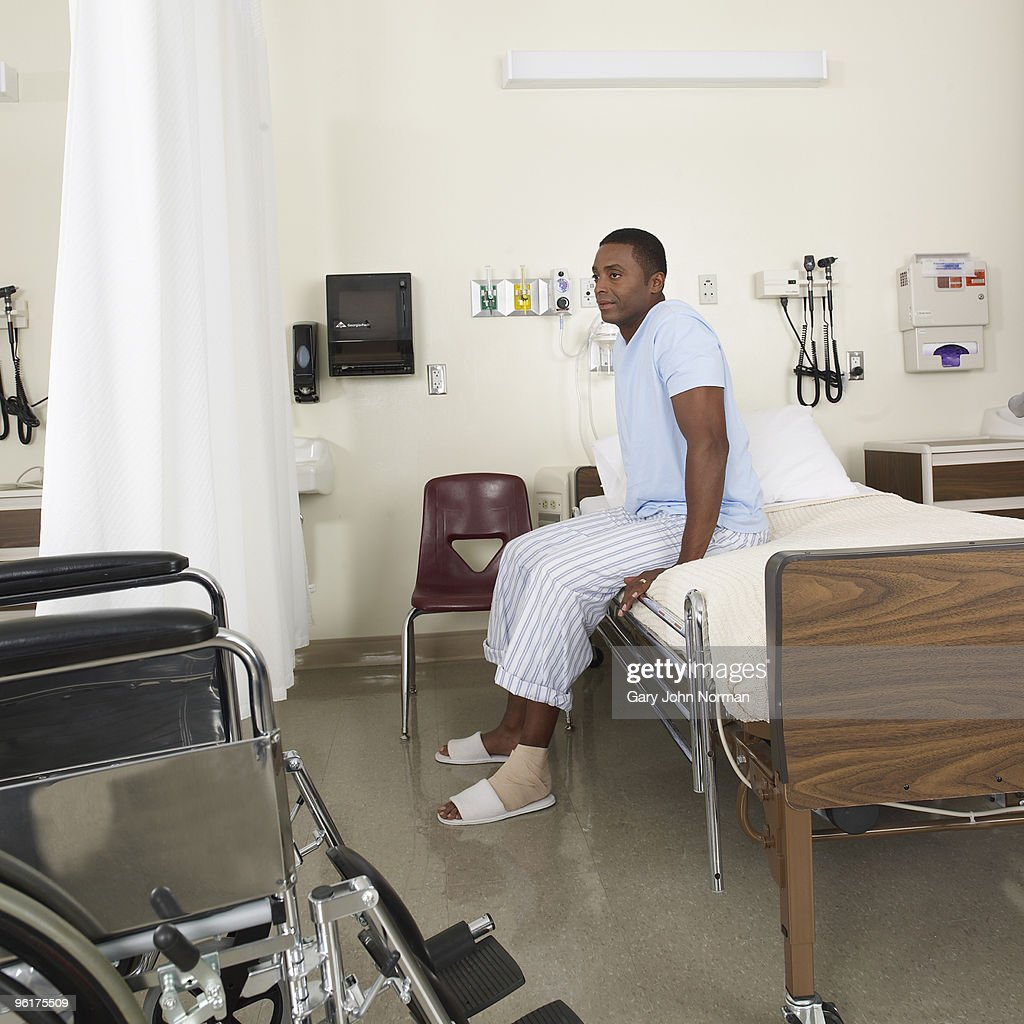Patient sits on edge of bed