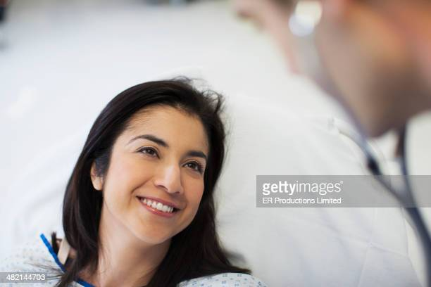 Patient smiling at doctor in hospital