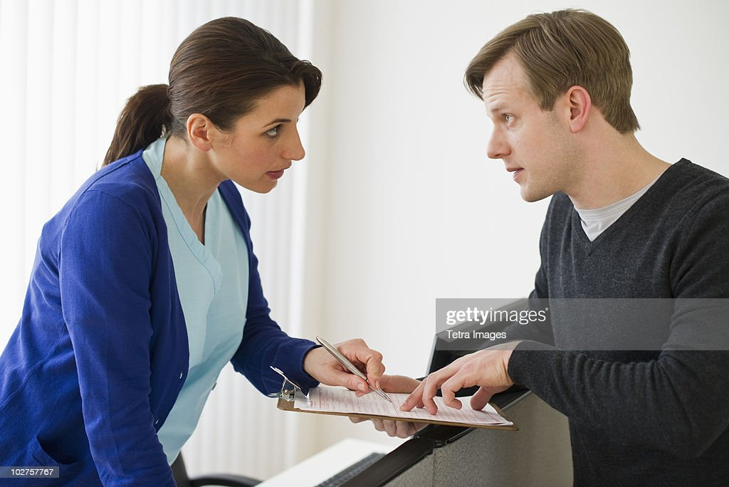 Patient talking to nurse : Stock Photo