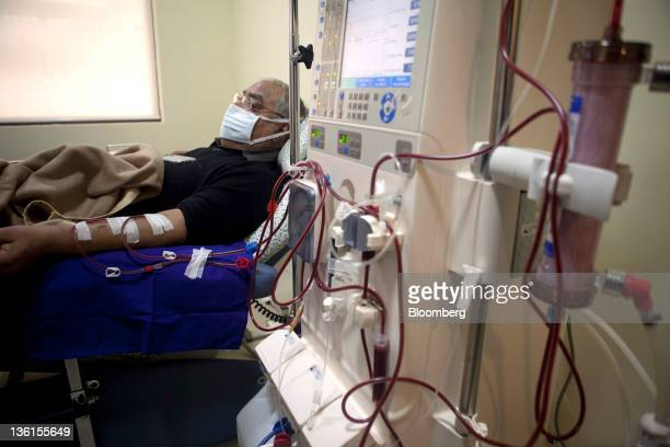 A patient undergoes dialysis aided by a Fresenius Medical Care AG machine at a Fortis Healthcare India Ltd Renkare dialysis clinic in New Delhi India...