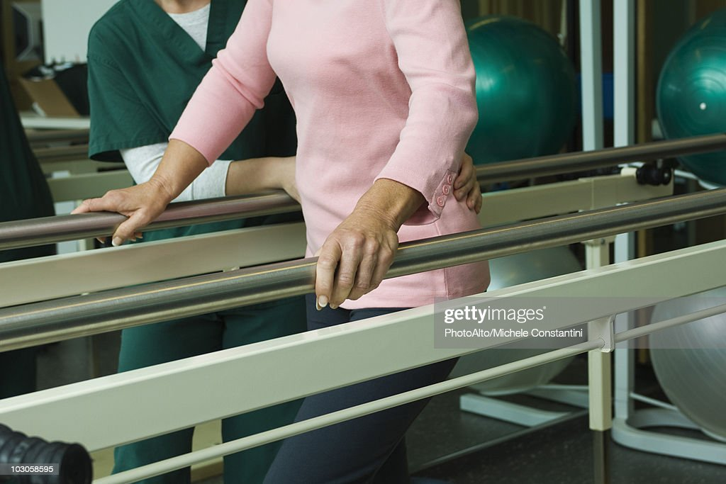 Patient undergoing post-surgery rehabilitation exercises to regain ability to walk