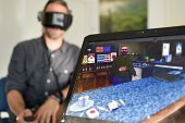 A patient wearing a virtual reality headset undertakes a VR therapy session with Dr Eric Malbos to help confront his phobias on October 8 2015 in the...