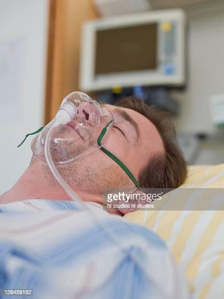 Patient wearing oxygen mask in hospital