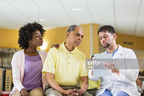 Patient with adult daughter talking to doctor