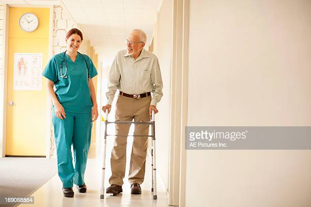 Patient with walker and healthcare professional