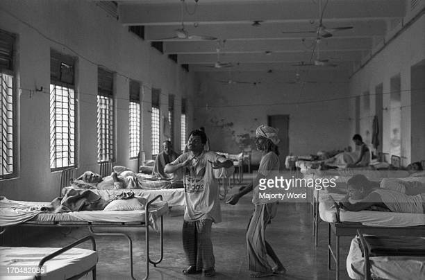 Patients are hyperactive in the morning and often sing and dance Mental Hospital Pabna in Bangladesh 1994 The Mental Hospital Pabna is the first...