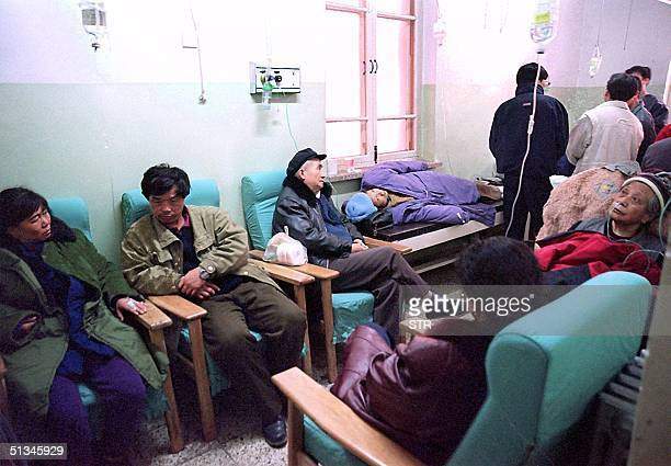 Patients cram into a waiting room at a hospital in Beijing 05 January as they wait for treatment A virulent flu virus continues to hit China's...