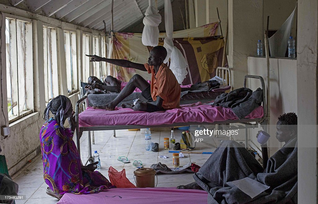 Patients injured during tribal clashes that erupted in Jonglei State, are pictured in a hospital in Bor, South Sudan on July 15. On July 12, 2013 over 126 people were taken by air to Bor Hospital. Among them 84 were wounded by gun shots. The clashes took place in Tangnyang, in Pibor county between the rival tribes of the Lou Nuer against the Murle. AFP PHOTO/Camille Lepage