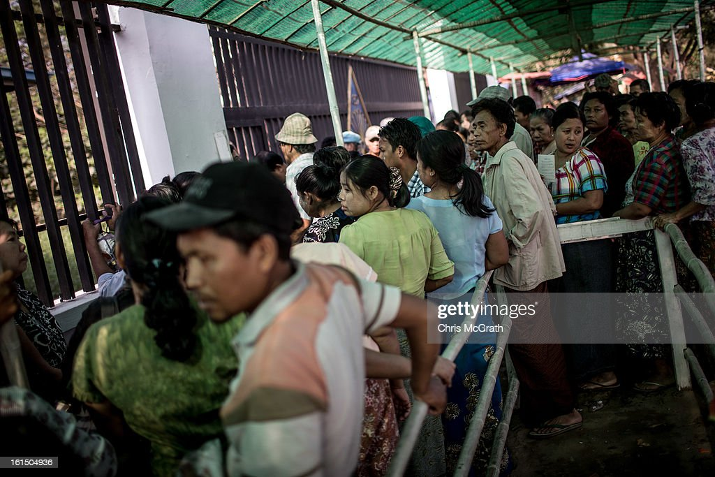 Patients lineup outside the free Thukha Charity Clinic waiting to put their name down for the next days doctors list in Botataung Touwnship, February 11, 2013 in Yangon, Burma. The free health clinic sees some 150 patients a day, with many people forced to sleep in line for several days to get on the examination list, for many across the country these clinics are their only option for basic healthcare as government run clinics are unaffordable. As the country goes through sweeping political and economic reforms, many are hopeful that after decades of neglect the healthcare system will also benefit from the changes. Although health budgets have increased the state health system is still underfunded and struggles to provide basic healthcare as well as essential medicines for treating HIV, Malaria and TB. With sanctions being lifted it is hopeful that again the flow of medical equipment, medicines and the presence of NGO's will increase.